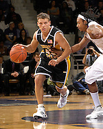 Kennesaw State guard Golden Ingle (43) drives against Kansas State's Blake Young (R) in the first half at Bramlage Coliseum in Manhattan, Kansas, December 17, 2006.  K-State beat Kennesaw State 82-54.<br />