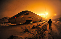 """File photo taken on Feb. 9, 2013 shows a bullet train arriving for maintenance in Changchun, capital of northeast China's Jilin Province. """"Building more high-speed railways"""" has been a hot topic at the annual sessions of China's provincial legislatures and political advisory bodies intensively held in January. China has the world's largest high-speed rail network, with the total operating length reaching 19,000 km by the end of 2015, about 60 percent of the world's total. The expanding high-speed rail network is offering unprecedented convenience and comfort to travelers, and boosting local development as well. Chinese companies have developed world-leading capabilities in building high-speed railways in extreme natural conditions. High-speed railway routes across China have been designed to suit its varying climate and geographical conditions. The Harbin-Dalian high-speed railway travels through areas where the temperature drops to as low as 40 degree Celsius below zero in winter, the Lanzhou-Xinjiang railway passes through the savage Gobi Desert and the Hainan Island railway can withstand a battering from typhoons. The China Railway Corp. plans to spend another 800 billion yuan (around 120 billion U.S. dollars) in 2016, especially in less-developed central and western regions. EXPA Pictures © 2016, PhotoCredit: EXPA/ Photoshot/ Wang Haofei<br /><br />*****ATTENTION - for AUT, SLO, CRO, SRB, BIH, MAZ only*****"""