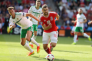 Sam Vokes of Wales breaks away from Jonny Evans of Northern Ireland. UEFA Euro 2016, last 16 , Wales v Northern Ireland at the Parc des Princes in Paris, France on Saturday 25th June 2016, pic by  Andrew Orchard, Andrew Orchard sports photography.