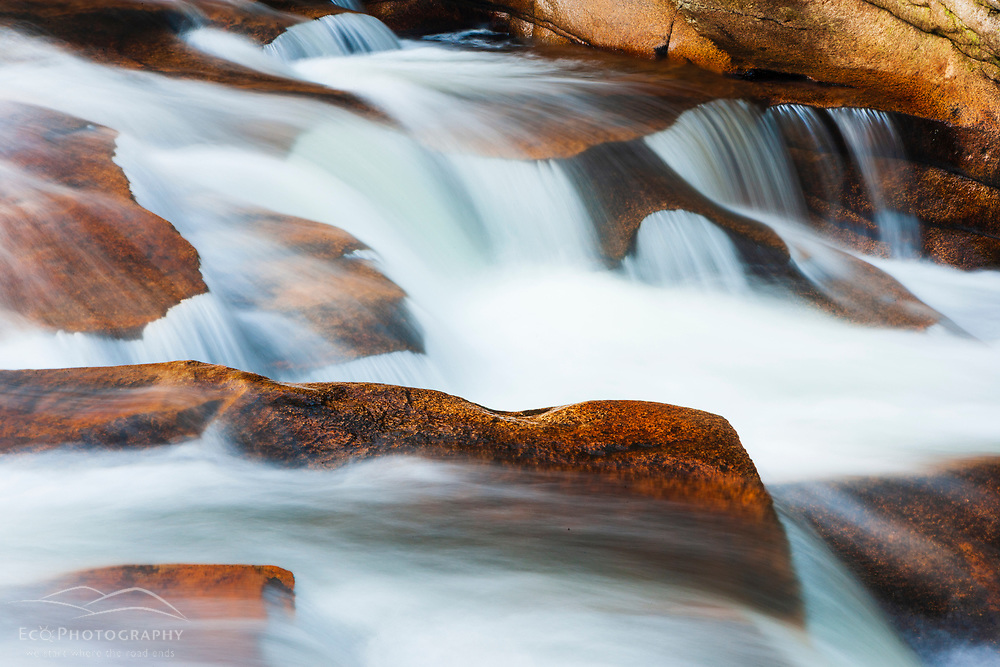 The cascades at Lower Falls on the Ammonoosuc River in New Hampshire's White Mountain National Forest.  Fall.