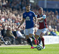 Everton's Kevin Mirallas shields the ball from Burnley's George Boyd<br /> <br /> Photographer Stephen White/CameraSport<br /> <br /> Football - Barclays Premiership - Everton v Burnley - Saturday 18th April 2015 - Goodison Park - Everton<br /> <br /> © CameraSport - 43 Linden Ave. Countesthorpe. Leicester. England. LE8 5PG - Tel: +44 (0) 116 277 4147 - admin@camerasport.com - www.camerasport.com