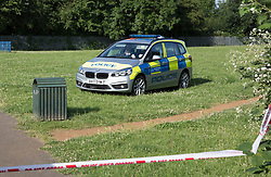 © Licensed to London News Pictures. 11/06/2018. London, UK. A police patrol car sits in a play area in Northolt after a 20 year old was stabbed last night.  Another youth was stabbed in nearby Harrow. Police said a male was arrested near the scene of the stabbing in Northolt.Photo credit: Peter Macdiarmid/LNP