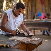 """Jesus the Carpenter<br /> <br /> Jesús Alberto Mayorga Lemus, Copán Ruinas<br /> <br /> """"We were poor. My parents couldn't afford to send us to school. So I decided to learn a trade to earn some money. I decided to learn carpentry and I went to work. I was 13. I didn't get paid for three years. My shoes were broken and I had patches in my trousers. It was hard. When I was visiting my girlfriend I had to hide the holes in my shoes by putting my foot up behind me.<br /> <br /> I've suffered, but you learn from suffering and you can use it to become better - a better son, a better brother, a better friend, a better husband. Without God, we aren't anything.<br /> <br /> I fell in love and got married when I was 16 and a half. We had four children."""""""