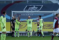 Football - 2020 / 2021 Premier League - Burnley vs. Newcastle United<br /> <br /> Newcastle United players challenge referee Anthony Taylor after he decides not to award them a first half penalty, at Turf Moor.<br /> <br /> <br /> COLORSPORT/ALAN MARTIN