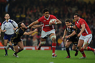Toby Faletau of Wales © breaks away from Scotland's Mike Blair (l). RBS Six nations championship 2012, Wales v Scotland at the Millennium Stadium in Cardiff on Sunday 12th Feb 2012.  pic by Andrew Orchard, Andrew Orchard sports photography,