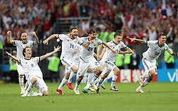 Russia's Mario Fernandes, Vladimir Granat, Aleksandr Yerokhin, Aleksandr Golovin, Fyodor Kudryashov, Roman Zobnin, Ilya Kutepov, and Fyodor Smolov celebrate defeating Spain 4-3 on penalties