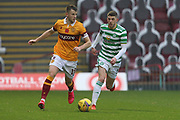 Liam Polworth (Motherwell) and Ryan Christie (Celtic) during the Scottish Premiership match between Motherwell and Celtic at Fir Park, Motherwell, Scotland on 8 November 2020.