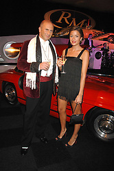 REBECCA LOOS and MICHAEL ROSS at a preview of a forthcoming sale of cars from the Bernie Ecclestone Car Collection held at Battersea Evolution, Battersea Park, London SW11 on 30th October 2007.<br />