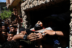 May 4, 2019 - Beit Hanoun, Gaza Strip 04 May 2019.  Imad Mohammed Nasir, 22, receives his final farewell during his funeral in the northern Gaza Strip after being killed in an Israeli airstrike in the northern Gaza Strip.  On Saturday Israeli airstrikes hit at least three separate areas of the  Gaza Strip and were responsible for killing Imad and wounding three other Palestinians. The air strikes were in response to the firing of dozens of rockets from Gaza into Israel early Saturday, which followed an Israeli attack on a Hamas site the previous day that had resulted in the death of two Palestinians (Credit Image: © Ahmad Hasaballah/IMAGESLIVE via ZUMA Wire)