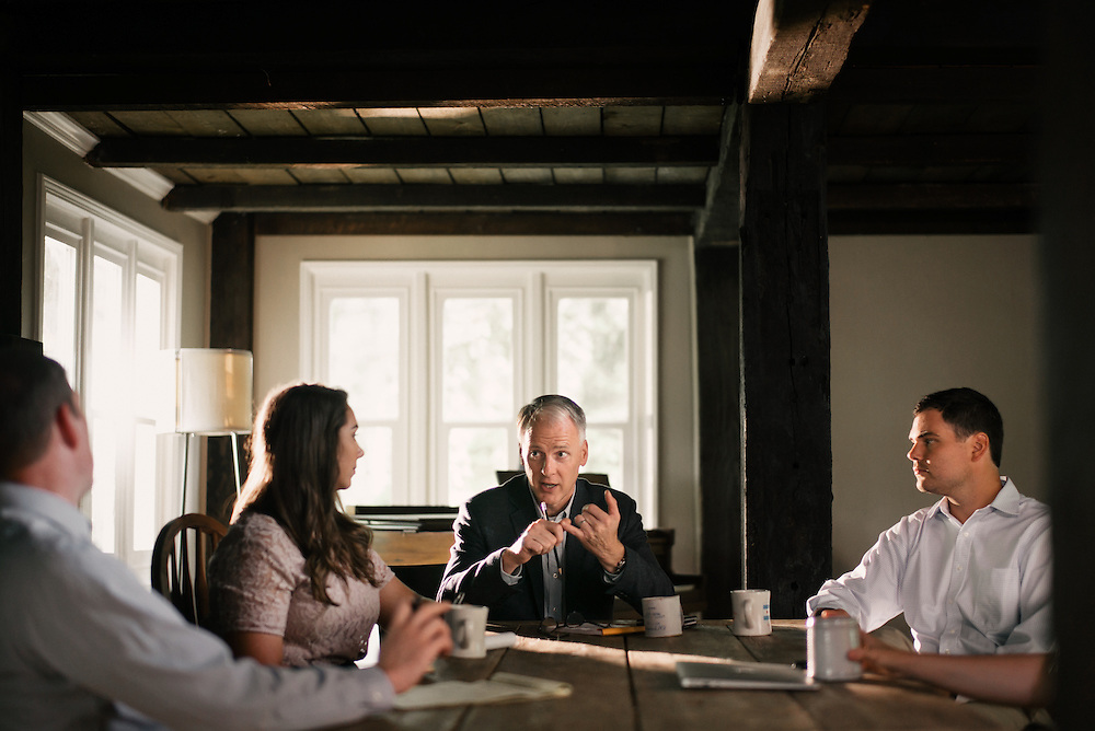 A small business executive leads a team meeting.
