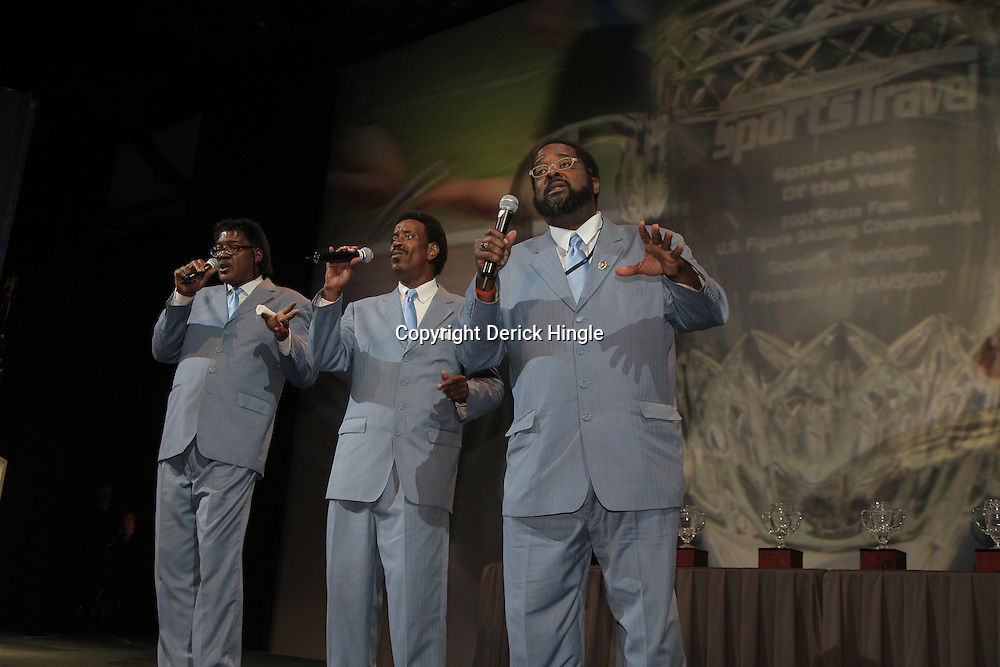 Jay-Ray & Gee A'Cappella Trio performs on stage at the Morial Convention Center in New Orleans, Louisiana.