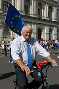 A Boris Johnson lookalike cycles among Pro-EU Remain protesters marching to Stop the Coup in Whitehall, near Downing Street, at the end of a week that saw Prime Minister Boris Johnson ask Queen Elizabeth for permission to suspend prorogue the British Parliament during the final stages of his Brexit negotiations with the European Union, in Brussels, on 31st August 2019, in Westminster, London, England.