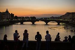Tourists on Ponte Santa Trinita at sunset, Florence, Italy. 26/08/15 Photo by Andrew Tallon