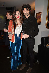 Iraira Mancini and Alex Zane at an exhibition of photographs by Erica Bergsmeds held at The Den, 100 Wardour Street, London England. 19 January 2017.