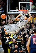 SHOT 2/14/13 8:49:29 PM - Colorado's Andre Roberson #21dunks against Arizona during their regular season Pac-12 basketball game at the Coors Event Center on the Colorado campus in Boulder, Co. Colorado won the game 71-58. (Photo by Marc Piscotty / © 2013)