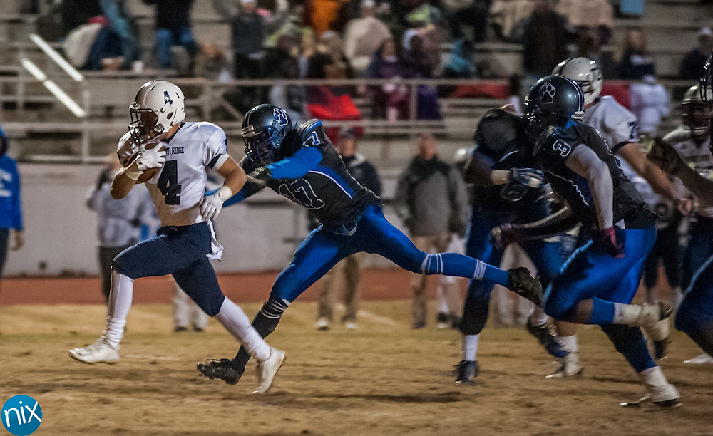 Hickory Ridge's Nate Mullen (4) carries the ball in for a touchdown against Statesville after the Ragin' Bulls recovered a fumble in the second half Friday night during the second round of the NCHSAA Playoffs. Statesville won the game 39-30.