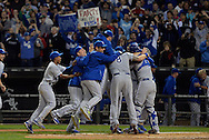The Kansas City Royals celebrate after the final out of the game against the Chicago White Sox at U.S. Cellular Field on September 26, 2014 in Chicago, Illinois. The Royals defeated the White Sox 3-1 to clinch a Wild Card berth, their first playoff appearance since 1985.  (Getty Images)