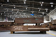 Columns marked save are some of the Artifacts chosen by curators out of the wreckage  from the World Trade Center  stored within an 80,000 square foot hanger at JFK airport, Hanger 17. Some of the artifacts will be in the National September 11 Memorial Museum set to open in 2012.