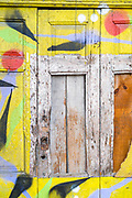 Bright colours on an old doorway and graphic patterns in Porto, Portugal
