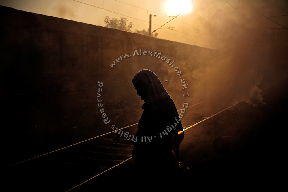 At dawn, a woman is standing by the railway tracks in New Arif Nagar, one of the water-contaminated colonies standing next to the abandoned Union Carbide (now DOW Chemical) industrial complex in Bhopal, central India, site of the infamous '1984 Gas Disaster'.  The poisonous cloud that enveloped Bhopal left everlasting consequences that today continue to consume people's lives.