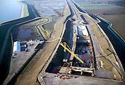 Nederland, Zeeland, Zuid-Beveland, Ellewoutsdijk, 15/11/2001; Noordelijke ingang en toerit Westerscheldetunnel met zeedijk Westerschelde (links); de tunnel wordt vanuit Zeeuwsch-Vlaanderen geboord, de boormachines zullen eindigen in de vierkante gaten (voorgrond) rechtsonder de bouwkraan. Bouw.<br /> luchtfoto (toeslag), aerial photo (additional fee)<br /> photo/foto Siebe Swart