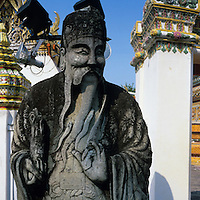Asia, Thailand, Bangkok, Statue along walls of Thanon Chetuphon on grounds of Wat Pho, the oldest and largest Buddhist temple in the city