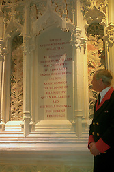 File photo dated 17/11/97 of State Apartment Warden, John Williams, observing a commemorative stone laid at the site where the fire of November 20th, 1992, began at Windsor Castle, as the Private Chapel where Archie Mountbatten-Windsor will be christened, had to be entirely rebuilt following the devastating fire.