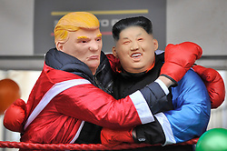 © Licensed to London News Pictures. 18/03/2018. LONDON, UK. People dressed as Donald Trump, US President, and Kim Jong-Un, North Korean leader, on a float during the parade. The 16th annual London St. Patrick's Day parade takes place through central London.  Tens of thousands of people enjoy the parade as well as festivities in Trafalgar Square.  The event showcases the best of Irish food, music, song, dance, culture and arts and this year, celebrates the achievements and successes of London's Irish women as part of the Mayor of London's #BehindEveryGreatCity campaign.   Photo credit: Stephen Chung/LNP