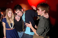 """Young people listen to """"Nue Rave"""" music and dance bands on stage at the se0ne Club underneath London Bridge Railway Station, London, Britain."""