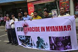 September 10, 2017 - Dhaka, Bangladesh - A group of Journalist protest hold up Placard demanding stop violence and Genocide on Rohinaya people in Myanmar near Myanmar Embassy in Dhaka, Bangladesh, on September 10, 2017. (Credit Image: © Str/NurPhoto via ZUMA Press)
