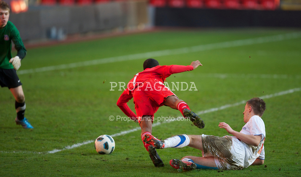 LIVERPOOL, ENGLAND - Saturday, January 8, 2011: Liverpool's Raheem Sterling is hacked down by Crystal Palace's Daniel Pringle for an extra-time penalty during the FA Youth Cup 4th Round match at Anfield. (Pic by: David Rawcliffe/Propaganda)
