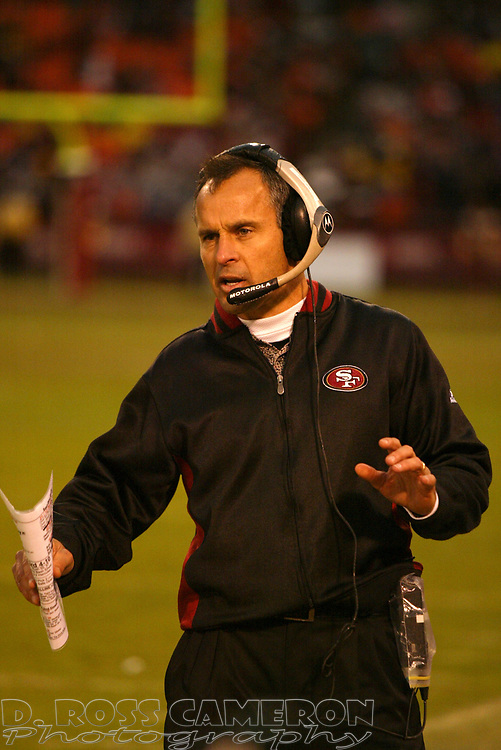San Francisco 49ers head coach talks on his headset during the third quarter of an NFL football game against the Houston Texans, Sunday, Jan. 1, 2006 at Candlestick Park in San Francisco.  The 49ers won in overtime, 20-17. (D. Ross Cameron/The Oakland Tribune)
