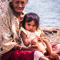 Generations of Bajau united. This grandma looks after the child of her daughter. She has spent her entire life on the ocean.