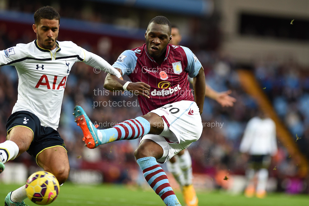Aston Villa's Christian Benteke is challenged by Tottenham's Kyle Naughton (16). Barclays premier league match, Aston Villa v Tottenham Hotspur at Villa Park in Birmingham on Sunday 2nd November 2014<br /> pic by Andrew Orchard, Andrew Orchard sports photography.