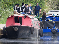 © Licensed to London News Pictures. 09/05/2021. London, UK. Member dot a police search team at the scene on the Canal at Old Oak Lane, near Harlesden, North West London, where the body of a baby was discovered in the water this afternoon. Photo credit: Ben Cawthra/LNP