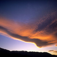 """A sunset illuminates """"Sierra Wave"""" lenticular clouds over Mount Tom & the Owens Valley, east of California's Sierra Nevada."""