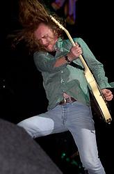 Thunder Guitarist Luke Morley on stage at Monsters of Rock Festival. Last night of an eleven date tour at the Hallam FM Arena, Sheffield Tuesday 26th November 2006<br /> <br /> Copyright Paul David Drabble<br /> Freelance Photographer<br /> 07831 853913<br /> 0114 2468406<br /> www.pauldaviddrabble.co.uk<br /> [#Beginning of Shooting Data Section]<br /> Nikon D1 <br /> 2002/11/26 20:13:58.4<br /> JPEG (8-bit) Fine<br /> Image Size:  2000 x 1312<br /> Color<br /> Lens: 80-200mm f/2.8-2.8<br /> Focal Length: 135mm<br /> Exposure Mode: Manual<br /> Metering Mode: Spot<br /> 1/250 sec - f/2.8<br /> Exposure Comp.: 0 EV<br /> Sensitivity: ISO 400<br /> White Balance: Auto<br /> AF Mode: AF-S<br /> Tone Comp: Normal<br /> Flash Sync Mode: Front Curtain<br /> Auto Flash Mode: External<br /> Color Mode: <br /> Hue Adjustment: <br /> Sharpening: Normal<br /> Noise Reduction: <br /> Image Comment: <br /> [#End of Shooting Data Section] Thunder Guitarist Luke Morley on stage at Monsters of Rock. Last night of an eleven date tour at the Hallam FM Arena, Sheffield Tuesday 26th November 2002<br /> <br /> Copyright Paul David Drabble<br /> Freelance Photographer<br /> 07831 853913<br /> 0114 2468406<br /> www.pauldaviddrabble.co.uk<br /> [#Beginning of Shooting Data Section]<br /> Nikon D1 <br /> 2002/11/26 20:13:58.4<br /> JPEG (8-bit) Fine<br /> Image Size:  2000 x 1312<br /> Color<br /> Lens: 80-200mm f/2.8-2.8<br /> Focal Length: 135mm<br /> Exposure Mode: Manual<br /> Metering Mode: Spot<br /> 1/250 sec - f/2.8<br /> Exposure Comp.: 0 EV<br /> Sensitivity: ISO 400<br /> White Balance: Auto<br /> AF Mode: AF-S<br /> Tone Comp: Normal<br /> Flash Sync Mode: Front Curtain<br /> Auto Flash Mode: External<br /> Color Mode: <br /> Hue Adjustment: <br /> Sharpening: Normal<br /> Noise Reduction: <br /> Image Comment: <br /> [#End of Shooting Data Section]