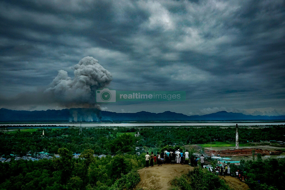 September 10, 2017 - Unspecified, Myanmar - There are more than 30000 rohingya taken the shelter in leda camp within last weeks. Most of new comer rohingya muslims claimed that, their houses has burned and relatives or family member was killed by myanmar militants which forced them to take shelter in Bangladesh. In the leda camp its easy to watch their mother land from the hills, few of rohingya spend plenty of times by staring to the border of myanmar beside of leda camp. On the 10 th september a large number of young rohingya found on the hill top behind the refugee camp; they were staring to their relatives' houses locates beside the border of the two countries,  few of them were calling the relatives from the hill to know their situation. (Credit Image: © Masfiqur Sohan/NurPhoto via ZUMA Press)