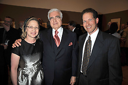 Left to right, DEBORAH STURMAN, American civil procedure scolar ARTHUR R MILLER and his son MATTHEW MILLER at a private view of the Kuniyoshi exhibition at the Royal Academy, Piccadilly, London on 17th March 2009.