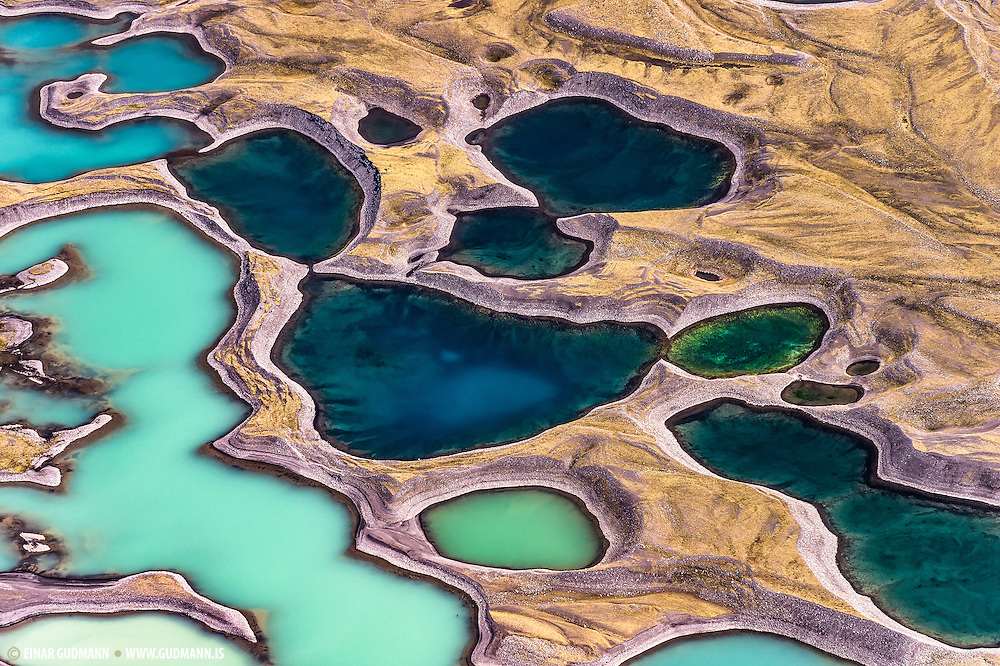 Below Sandfellsjokull which is a part of Myrdalsjökull there are these colorful lakes in the sands.