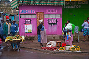 Vendors sell vegetables and fruit outside a marketplace pub in Narok, Kenya.