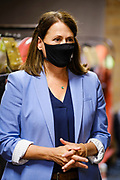 14 JULY 2020 - ADEL, IOWA: THERESA GREENFIELD, wearing a Coronavirus face mask, at the Adel Family Fun Center, a bowling alley in Adel, IA, about 25 miles west of Des Moines. Theresa Greenfield, a Democrat, is running for the US Senate against incumbent Senator Joni Ernst. Recent polls have Greenfield slightly ahead of or statistically tied with Ernst, who is closely allied with President Donald Trump. This was one of Greenfield's first live campaign events since the Coronavirus pandemic shutdown started in March. She has been campaigning virtually using teleconferencing apps.     PHOTO BY JACK KURTZ