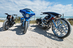 Arlen, Zach and Cory Ness' bikes (including Cory's side-by-side twin engine custom) at High Tides restaurant in Flagler Beach north of Daytona during the Daytona Bike Week 75th Anniversary event. FL, USA. Monday March 7, 2016.  Photography ©2016 Michael Lichter.