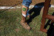 A tractor driver shows off his tattoo during a tractor pull in Girard, Kansas, Sep. 6, 2010.