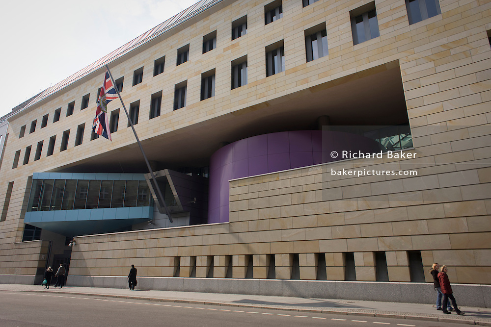 A wide panorama of the exterior of the British Embassy, the United Kingdom's diplomatic mission to Germany in Berlin. It is located on 70-71 Wilhelmstraße, near the Hotel Adlon. Upon reunification in 1991, an architectural competition was won by Michael Wilford and the new building opened by Queen Elizabeth II on 18 July 2000.