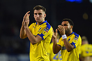 Ben Purrington (3) of AFC Wimbledon applauds the travelling fans at full time after a 2-1 loss to Portsmouth during the EFL Sky Bet League 1 match between Portsmouth and AFC Wimbledon at Fratton Park, Portsmouth, England on 1 January 2019.