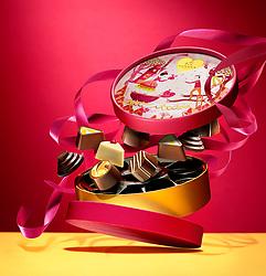 Valentine's Day Box of Chocolates in motion. Godiva pralines in motion.