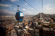 View from the cable car. Complexo do Alemao favela is one of the largest favela complexes in Brazil. Seen from above in the cable car, it stretches as far as the eye can see. Unfortunately recently it has been the location of shootouts between Police UPP and gangs who control the area. Rio de Janeiro, Brazil.