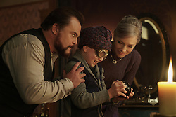 """Uncle Jonathan (Jack Black, left) and Mrs. Zimmerman (Cate Blanchett, right) wait to see if Jonathan's nephew Lewis (Owen Vaccaro) can solve a mystery with a Magic 8 ball in """"The House With A Clock in Its Walls,"""" (2018)"""