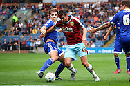 James Tarkowski of Brentford (l) looks to tackle Lukas Jutkiewicz of Burnley. Skybet football league championship match, Burnley  v Brentford at Turf Moor in Burnley, Lancs on Saturday 22nd August 2015.<br /> pic by Chris Stading, Andrew Orchard sports photography.